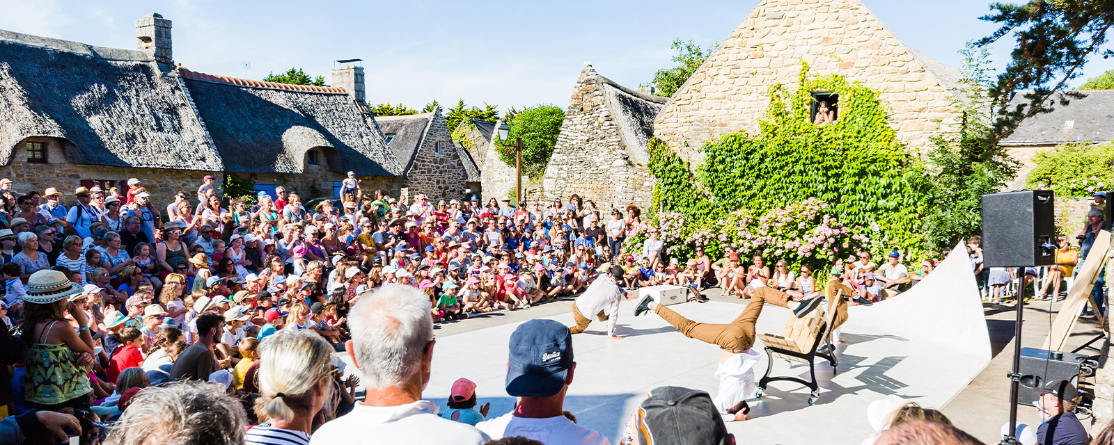 Hip Hop demonstration within the thatched houses hamlet